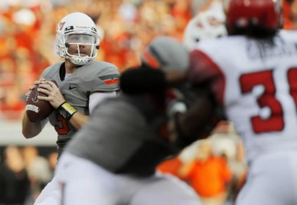 Photo - OSU's Brandon Weeden (3) looks to pass during a college football game between the Oklahoma State Cowboys (OSU) and the University of Louisiana at Lafayette (ULL) Ragin' Cajuns at Boone Pickens Stadium in Stillwater, Okla., Saturday, Sept. 3, 2011. Photo by Nate Billings, The Oklahoman ORG XMIT: KOD