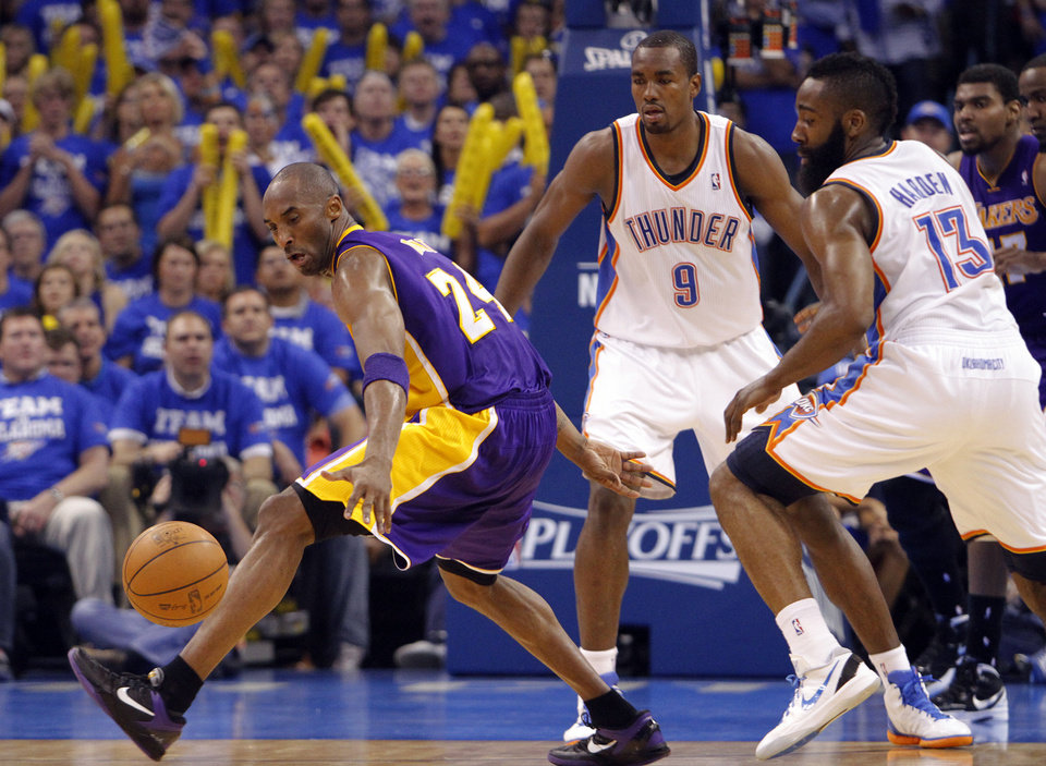 Photo - Los Angeles' Kobe Bryant looses the ball under the pressure of Oklahoma City's James Harden during Game 2 in the second round of the NBA playoffs between the Oklahoma City Thunder and the L.A. Lakers at Chesapeake Energy Arena on Wednesday,  May 16, 2012, in Oklahoma City, Oklahoma. Photo by Chris Landsberger, The Oklahoman