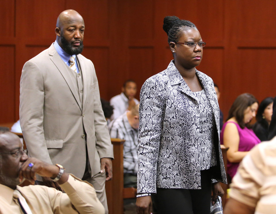 Photo - The parents of Trayvon Martin, Tracy Martin and Sybrina Fulton, arrive at the trial for George Zimmerman in Seminole Circuit Court, in Sanford, Fla., Tuesday, July  9, 2013. Zimmerman is charged with second-degree murder in the fatal shooting of Trayvon Martin, an unarmed teen, in 2012. (AP Photo/Orlando Sentinel, Joe Burbank, Pool)