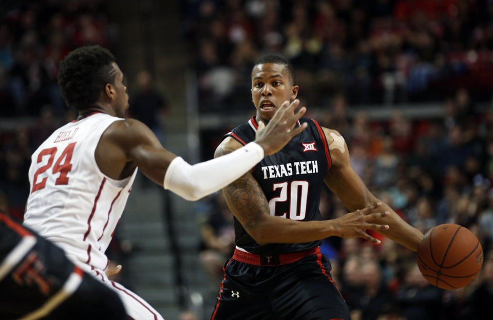 Photo - Texas Tech's Toddrick Gotcher tries to pass the ball around Oklahoma's Buddy Hield during the first half of an NCAA college basketball game on Wednesday, Feb. 17, 2016 in Lubbock, Texas. (AP Photo/Brad Tollefson)