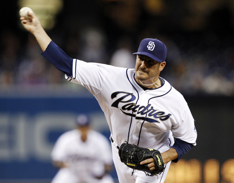 Photo - San Diego Padres starting pitcher Jason Marquis delivers against the Milwaukee Brewers in the first inning of a baseball game, Monday, April 22, 2013, in San Diego. (AP Photo/Alex Gallardo)