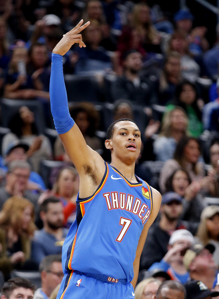 Photo - Oklahoma City's Darius Bazley (7) celebrates a 3-point basket during the NBA game between the Oklahoma City Thunder and the Golden State Warriors at Chesapeake Energy Arena,   Saturday, Nov. 9, 2019.  [Sarah Phipps/The Oklahoman]