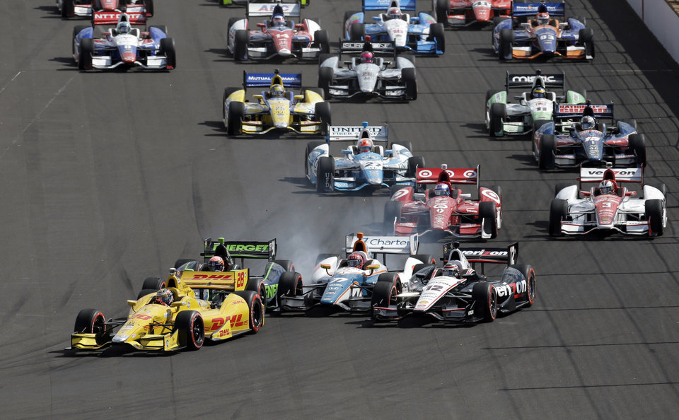 Photo - Ryan Hunter-Reay leads the field on the restart of the inaugural Grand Prix of Indianapolis IndyCar auto race at the Indianapolis Motor Speedway in Indianapolis, Saturday, May 10, 2014. (AP Photo/Darron Cummings)