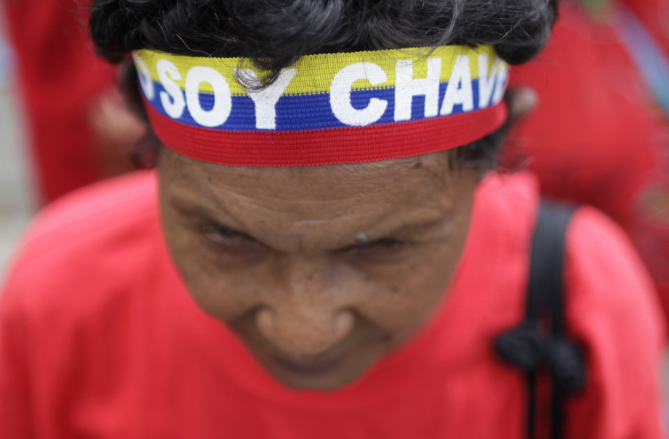Photo - A supporter of Venezuela's President Hugo Chavez wears a headband that reads in Spanish