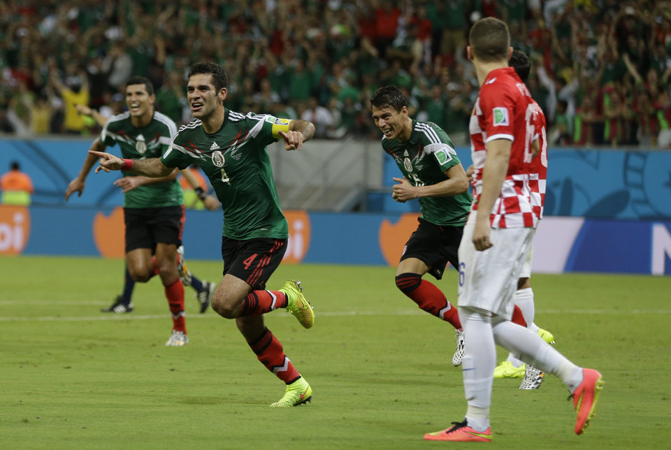 Photo - Mexico's Rafael Marquez celebrates after scoring  the first goal of his team during the group A World Cup soccer match between Croatia and Mexico at the Arena Pernambuco in Recife, Brazil, Monday, June 23, 2014. Mexico won 3-1.(AP Photo/Ricardo Mazalan)