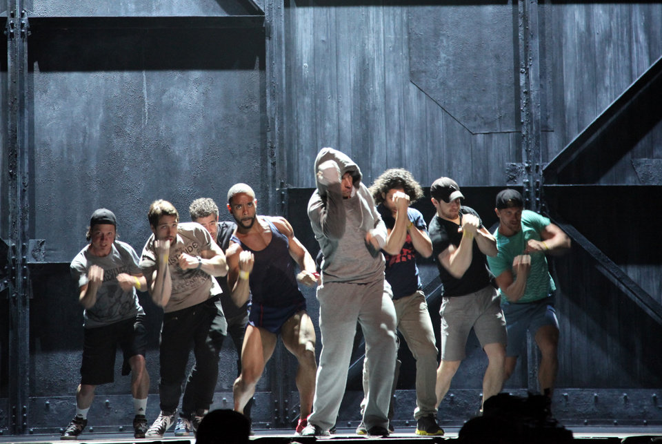 Photo - Andy Karl, center, performs with the cast of