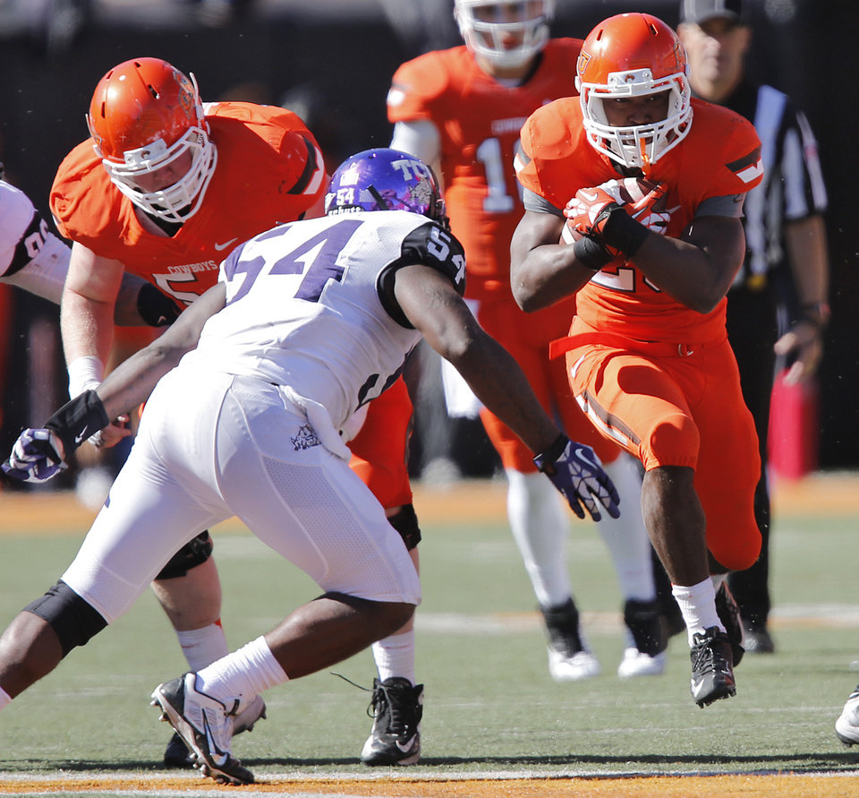 Oklahoma State\'s Rennie Childs (23) runs past TCU\'s Marcus Mallet (54) during a college football game between the Oklahoma State University Cowboys (OSU) and the Texas Christian University Horned Frogs (TCU) at Boone Pickens Stadium in Stillwater, Okla., Saturday, Oct. 19, 2013. Photo by Chris Landsberger, The Oklahoman