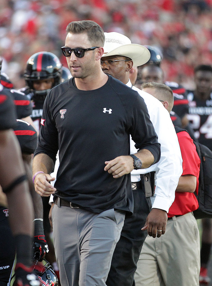 Photo - Texas Tech head coach Kliff Kingsbury leaves the field at halftime against Central Arkansas during an NCAA college football game in Lubbock, Texas, Saturday, Aug. 30, 2014. (AP Photo/Lubbock Avalanche-Journal, Tori Eichberger) ALL LOCAL TELEVISION OUT
