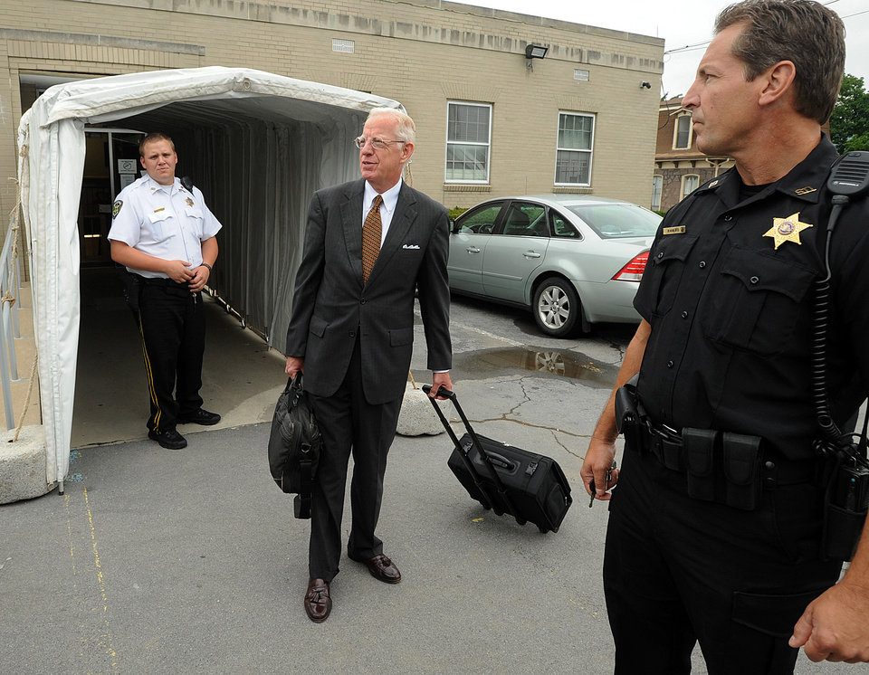 Photo -   Judge John Cleland leaves the Centre County Courthouse, in Bellefonte, Pa., Monday, June 18, 2012. The defense began presenting it's case in Jerry Sandusky's trial on 52 counts of child sexual abuse involving 10 boys over a period of 15 years on Monday. (AP Photo/Centre Daily Times, Nabil K. Mark)