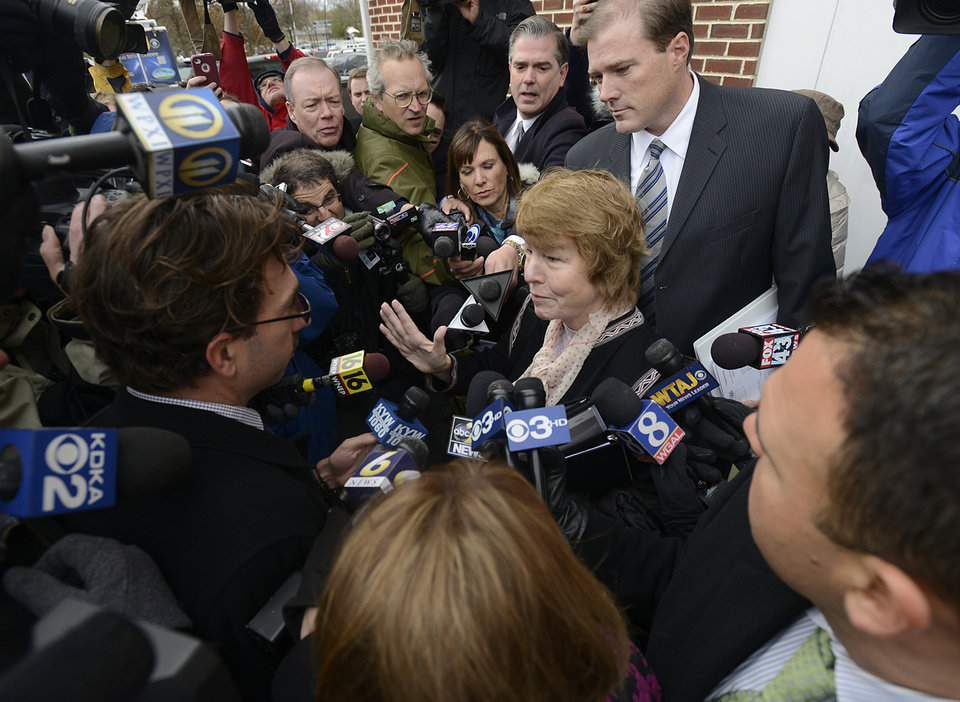 Former Penn State University President Graham Spanier's attorneys, Elizabeth Ainslie, center, and Edward Spreha, back right, talk to media at Harrisburg District Judge William Wenner's office Wednesday Nov. 7, 2012 following the arraignment. Spanier was arraigned and released on bail at the brief court appearance on charges he lied about and concealed child sex abuse allegations involving former assistant football coach Jerry Sandusky. (AP Photo/Jason Minick)