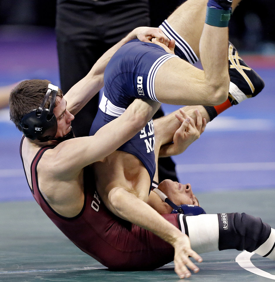 Photo - Oklahoma's Jarrod Patterson takes on Penn State's Nicholas Megaludis in the 125 pound match during the 2014 NCAA Div. 1 Wrestling Championships at Chesapeake Energy Arena in Oklahoma City, Okla. on Friday, March 21, 2014. Photo by Chris Landsberger, The Oklahoman