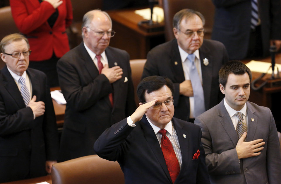 Photo - Lawmakers honor the American flag during the pledge of allegiance at the beginning of Monday's session.  Saluting is Rep. Mike Ritze. Gov. Mary Fallin outlined her goals for the upcoming legislative session during her state of the state speech to a joint session of the legislature in the House chamber at the state Capitol on Monday, Feb. 3, 2014.   Photo by Jim Beckel, The Oklahoman