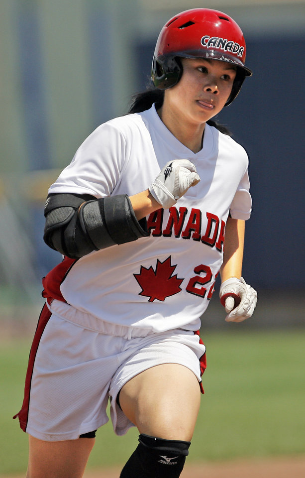 Photo - Canada's Jennifer Yee runs the bases after hitting a home run in the fifth inning against Australia.  (Photo by Nate Billings, The Oklahoman)