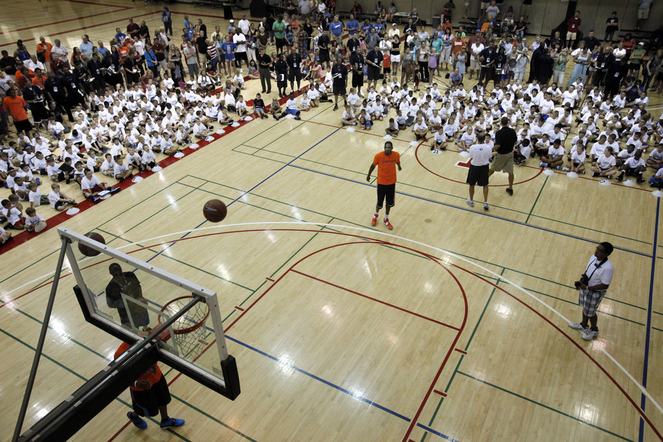 Photo - Kevin Durant shoots baskets during his basketball camp on Thursday, June 28, 2012, in Norman, Okla.  Photo by Steve Sisney, The Oklahoman