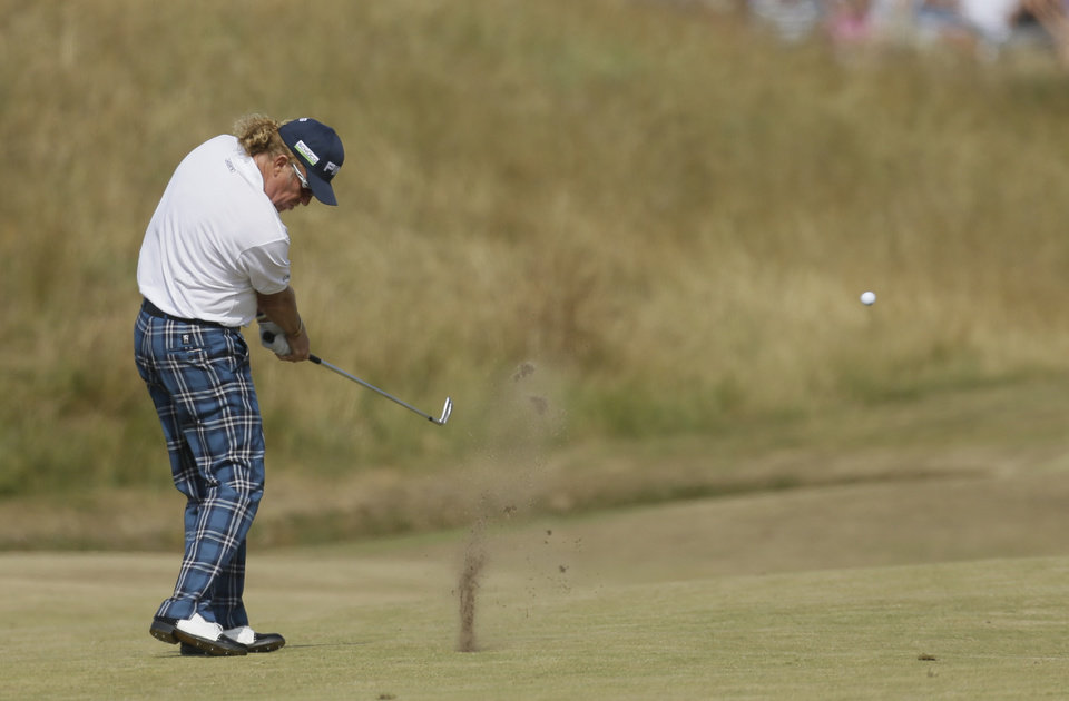 Photo - Miguel Angel Jimenez of Spain plays a shot on the third fairway during the third round of the British Open Golf Championship at Muirfield, Scotland, Saturday July 20, 2013. (AP Photo/Jon Super)