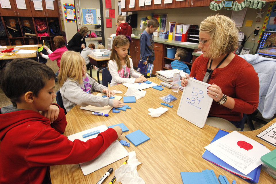 Second graders  Kabl Kahkesh, Mia Sanchez and Brynna Conaway work on a math lesson with teacher Mindi Mendez at Centennial Elementary School in Edmond.  Photo By David McDaniel/The Oklahoman <strong>David McDaniel - The Oklahoman</strong>