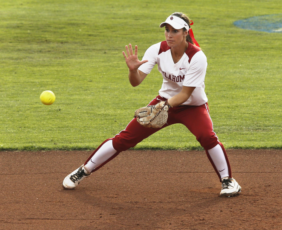 Photo - Infielder Jessica Vest makes a catch during the NCAA Super Regional softball game as the University of Oklahoma (OU) Sooners defeats Texas A&M 10-2 at Marita Hines Field on Friday, May 24, 2013 in Norman, Okla. Photo by Steve Sisney, The Oklahoman