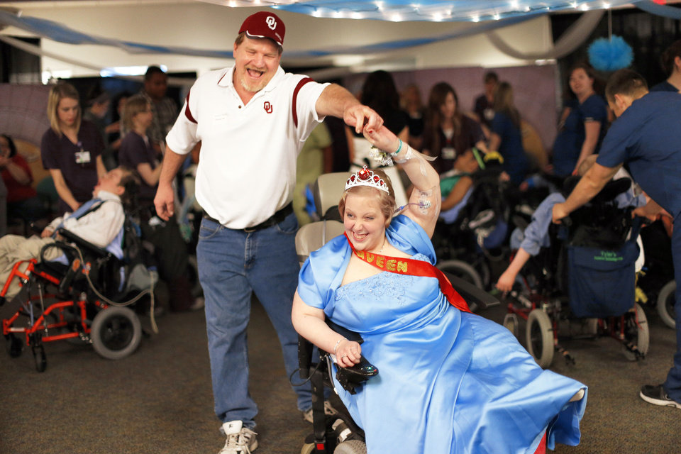 Hayle Savage dances Thursday with her soon-to- be stepfather, Darin McDaniel, at The Children's Center in Bethany. Photo by Sarah Phipps, The Oklahoman <strong>SARAH PHIPPS - SARAH PHIPPS</strong>