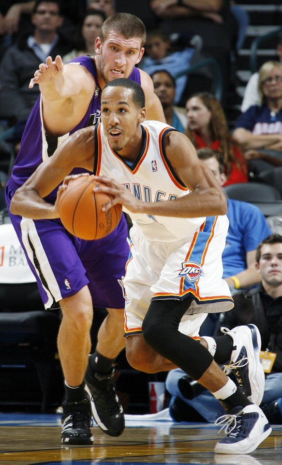 Shaun Livingston (14) of Oklahoma City looks to pass the ball away from Spencer Hawes (31) of Sacramento during the NBA preseason game between the Sacramento Kings and the Oklahoma City Thunder at the Ford Center in Oklahoma City, Thursday, Oct. 22, 2009. Sacramento won, 104-89. Photo by Nate Billings, The Oklahoman