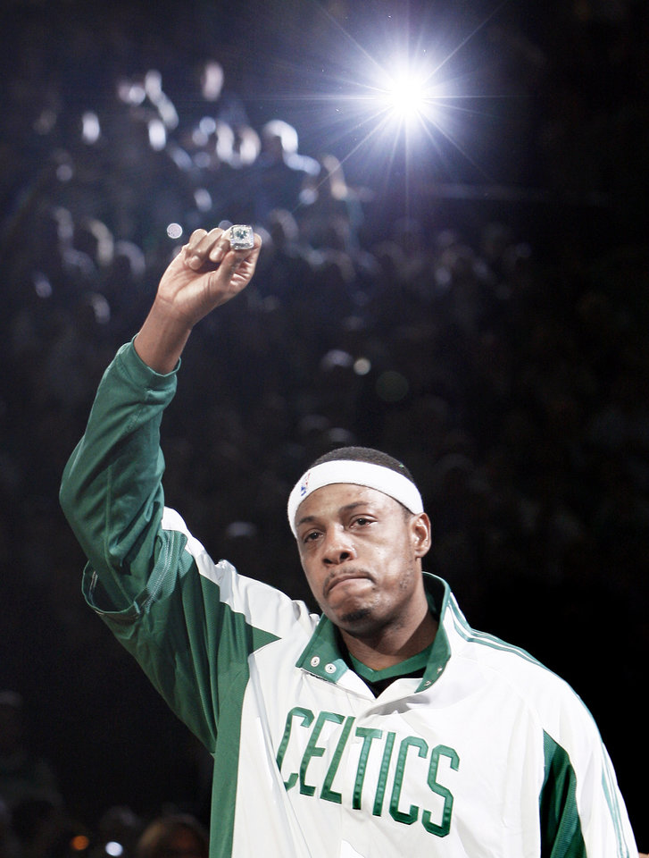 Boston's Paul Pierce holds his NBA championship ring up to the crowd during a ceremony earlier this season. AP photo