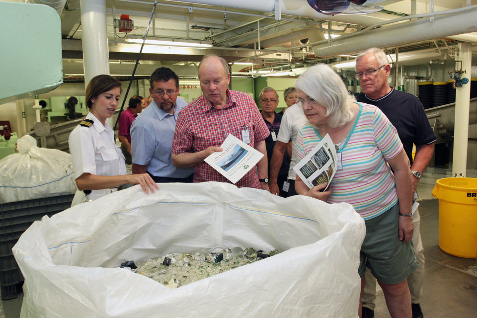 This undated image from Cunard shows passengers on the Queen Mary 2 looking into a recycling bin in the waste-handling facility of the ship.  Cunard is offering back of the house tours where passengers can look at areas that are normally off-limits to guests, from the galley to the engine room. The tours are among a number of new attractions and activities being offered onboard ships as the 2013 cruise season gets under way. (AP Photo/Cunard)