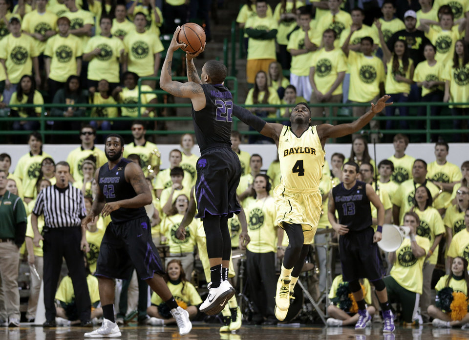 Kansas State\' Rodney McGruder (22) scores a three-point basket as Baylor guard Gary Franklin (4) defends in the final second of an NCAA college basketball game on Saturday, March 2, 2013, in Waco, Texas. Kansas State won 64-61. (AP Photo/Tony Gutierrez)