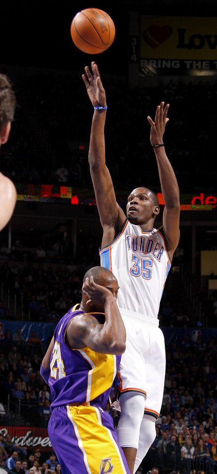 Oklahoma City\'s Kevin Durant (35) shoots the ball behind Los Angeles\' Kobe Bryant (24) during an NBA basketball game between the Oklahoma City Thunder and the Los Angeles Lakers at Chesapeake Energy Arena in Oklahoma City, Thursday, Feb. 23, 2012. Photo by Bryan Terry, The Oklahoman