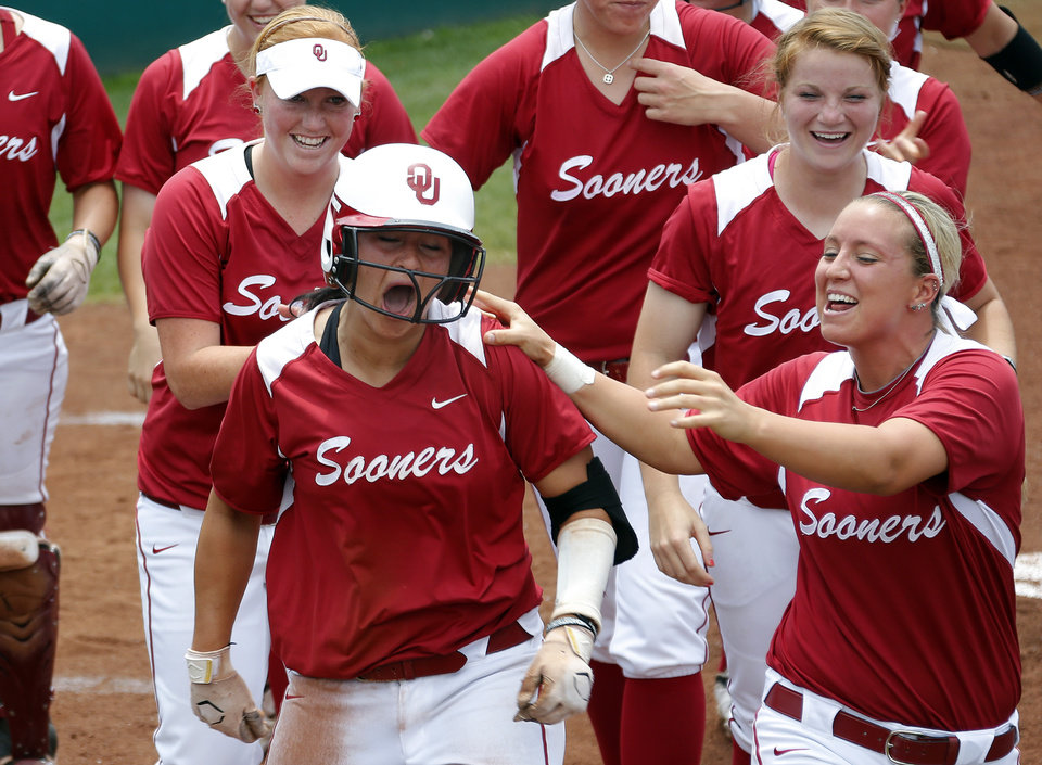 Photo - Lauren Chamberlain celebrates a home run during the Norman Regional of the 2013 NCAA Division I Softball Women's College World Series as the University of Oklahoma (OU) Sooners play the Arkansas Razorbacks at Marita Hines Field, Sunday, May 19, 2013. Photo by Sarah Phipps, The Oklahoman