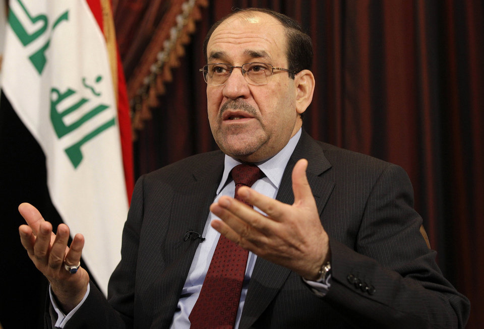 Photo - FILE - This Dec. 3, 2011 file photo shows Iraq's Shiite Prime Minister Nouri al-Maliki talks during an interview with The Associated Press in Baghdad, Iraq. The prospect of the U.S. military returning to the fight in Iraq has turned congressional hawks into doves. Lawmakers who eagerly voted to authorize military force 12 years ago to oust Saddam Hussein and destroy weapons of mass destruction that were never found now harbor doubts that air strikes will turn back insurgents threatening Prime Minister Nouri al-Maliki's government and Baghdad. (AP Photo/Hadi Mizban, File)