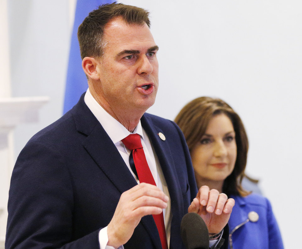 Photo -  Gov. Kevin Stitt speaks at the Blue Room as Joy Hofmeister looks on as Oklahoma government officials have a press conference to discuss the state's response to the Covid-19 Thursday, March 12, 2020.  [Photo by Doug Hoke/The Oklahoman]
