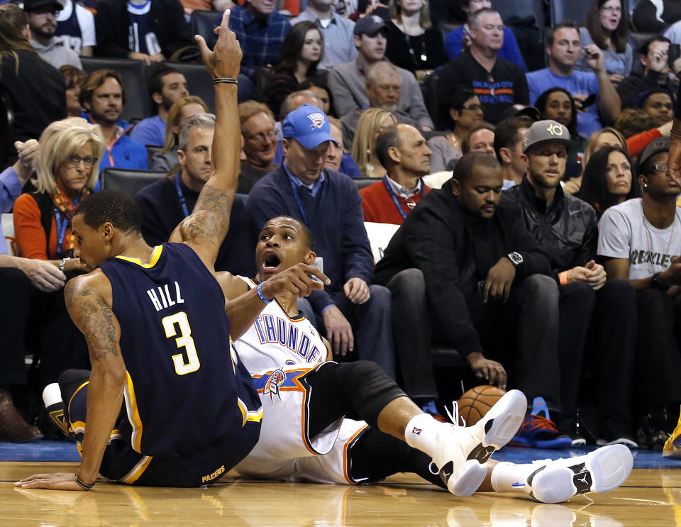 Russell Westbrook (0) reacts to a foul next after diving for a ball with Indiana's George Hill (3) during the NBA game between the Oklahoma City Thunder and the Indiana Pacers at the Chesapeake Energy Arena, Sunday, Dec. 8, 2013. Photo by Sarah Phipps, The Oklahoman
