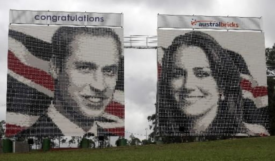 Photo - Two 100 foot mosaic brick walls of Britain's Prince William and Kate Middleton stand in a open field beside a busy express-way in Sydney, Australia, Thursday, April 28, 2011.(AP Photo/Rob Griffith)