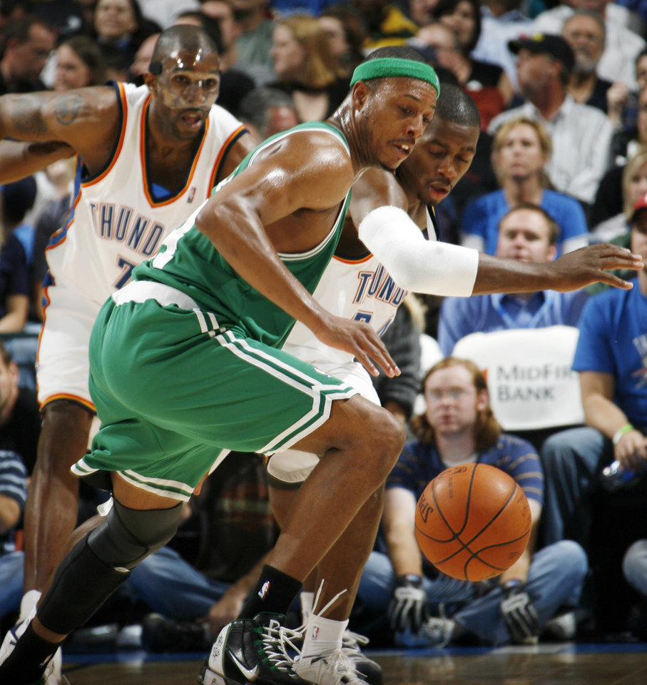 Photo - Boston's Paul Pierce, middle, Desmond Mason, right, and Joe Smith, left, of the Thunder chase a loose ball in the second half during the NBA basketball game between the Oklahoma City Thunder and the Boston Celtics at the Ford Center in Oklahoma City, Wednesday, Nov. 5, 2008. Boston won, 96-83. BY NATE BILLINGS, THE OKLAHOMAN