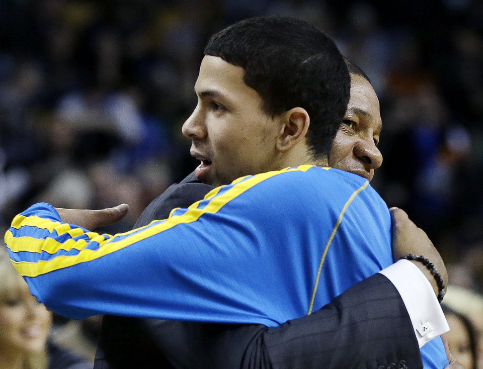 Boston Celtics head coach Doc Rivers, right, hugs his son, New Orleans Hornets shooting guard Austin Rivers, prior to an NBA basketball game in Boston, Wednesday, Jan. 16, 2013. (AP Photo/Elise Amendola)