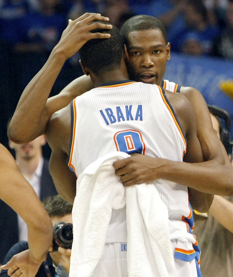 Photo - Oklahoma City's Kevin Durant hugs Serge Ibaka following their win over Denver during the first round NBA Playoff basketball game between the Thunder and the Nuggets at OKC Arena in downtown Oklahoma City on Wednesday, April 20, 2011. The Thunder beat the Nuggets 106-89 and lead the series 2-0. Photo by John Clanton, The Oklahoman