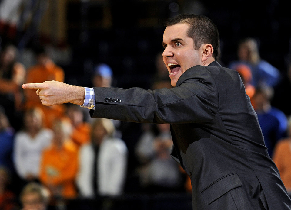 Photo - Mississippi coach Matt Insell points during the first half of his team's NCAA college basketball game against Tennessee in Oxford, Miss., Thursday, Feb. 6, 2014. (AP Photo/Thomas Graning)