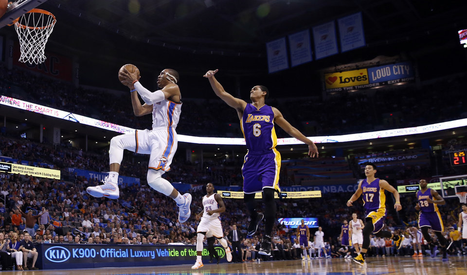 Photo - Oklahoma City's Russell Westbrook (0) scores on a fast break during the second half of the NBA basketball game where the Oklahoma City Thunder defeated the Los Angeles Lakers 127-117 at Chesapeake Energy Arena on March 24, 2015 in Oklahoma City, Okla. Photo by Steve Sisney, The Oklahoman