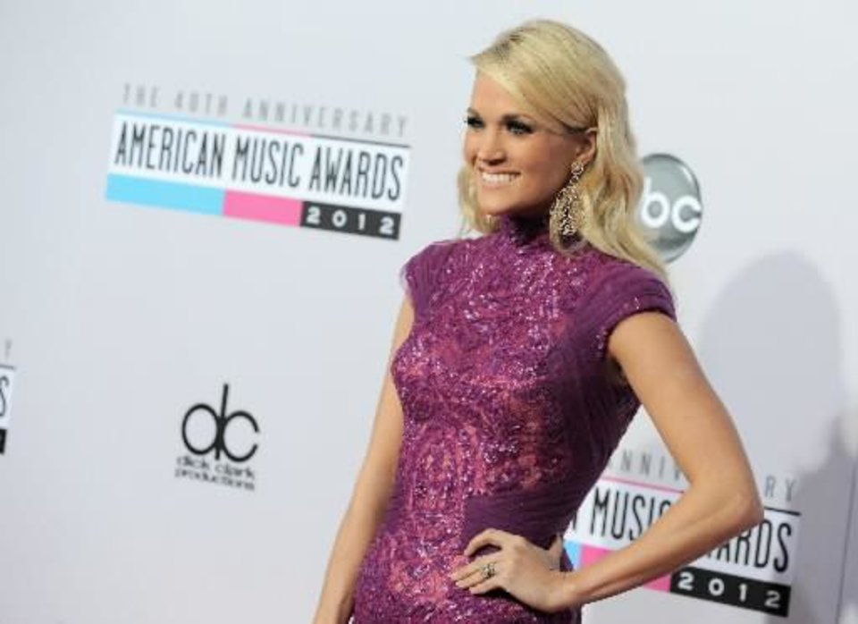 Photo -  Carrie Underwood arrives at the 40th Anniversary American Music Awards on Sunday, Nov. 18, 2012, in Los Angeles. (AP)