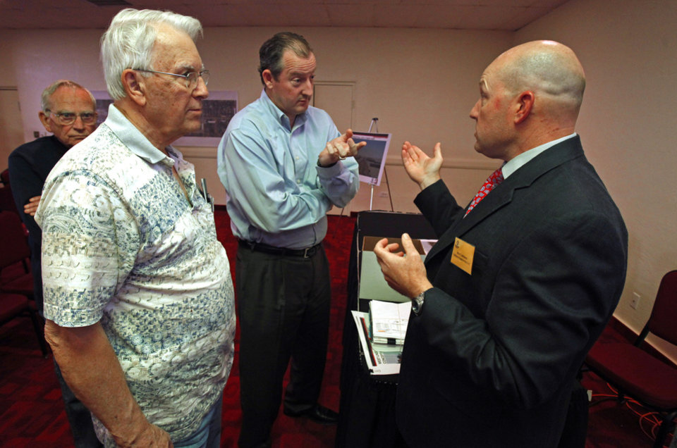 Dr. Pat Garrison, DVM and property owner Robert Castleberry (center) talk with engineer Bret Cabbiness (right) after an informational meeting about widening Lindsey between Interstate 35 and Berry Road on Thursday, March 15, 2012, in Norman, Okla.  Photo by Steve Sisney, The Oklahoman