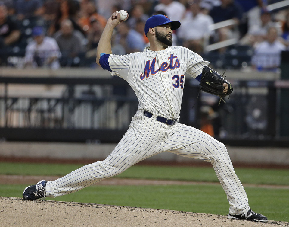Photo - New York Mets pitcher Dillon Gee (35) delivers against the Atlanta Braves during the fourth inning of a baseball game, Wednesday, July 9, 2014, in New York. (AP Photo/Julie Jacobson)