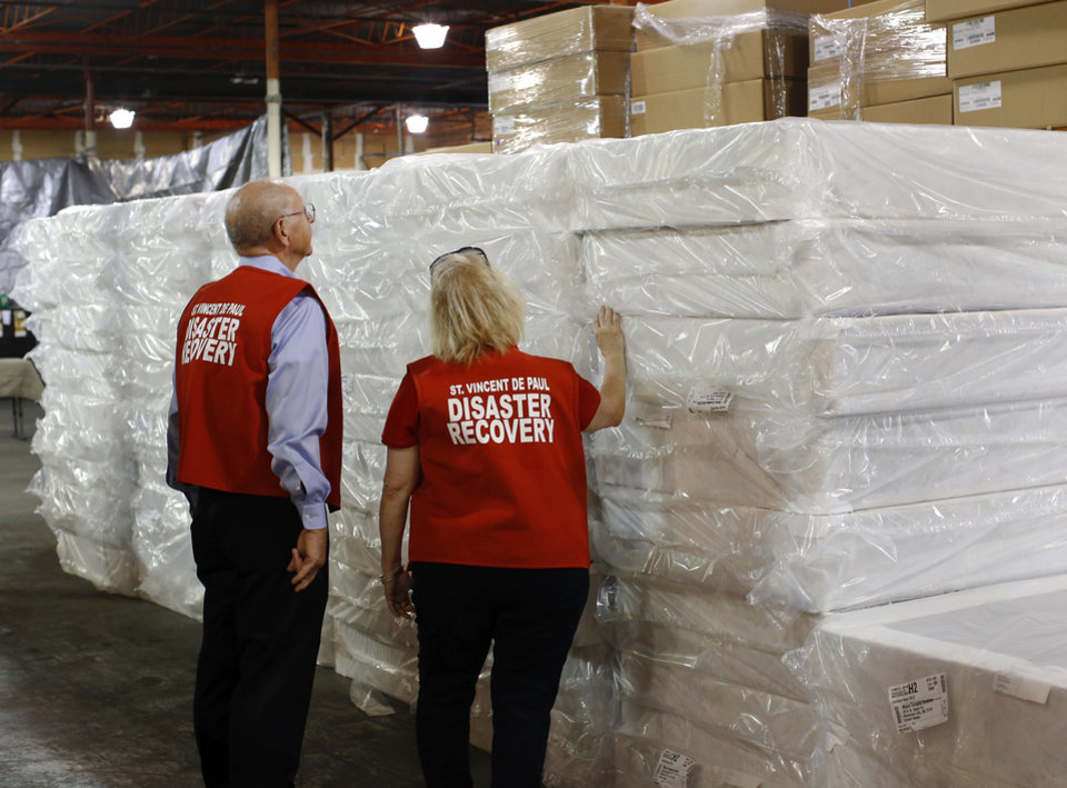 Photo - Ralph Hassel and Elizabeth Disco-Shearer check mattresses to be distributed to tornado victims as part of the