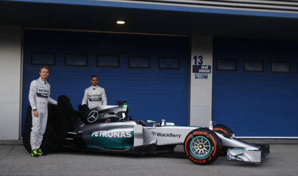 Photo - Mercedes GP drivers Nico Rosberg of Germany, left, and Lewis Hamilton of Great Britain, right, pose for photos during the launch of their new Mercedes W05 Formula One car at the Circuito de Jerez on Tuesday, Jan. 28, 2014, in Jerez de la Frontera, Spain. (AP Photo/Miguel Angel Morenatti)