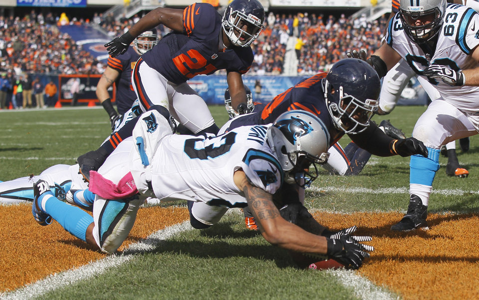 Photo -   Carolina Panthers wide receiver Louis Murphy (83) recovers a fumble in the end zone for a touchdown against the Chicago Bears during the first half of an NFL football game in Chicago, Sunday, Oct. 28, 2012. Ther ball was fumbled by Panthers quarterback Cam Newton. (AP Photo/Charles Rex Arbogast)