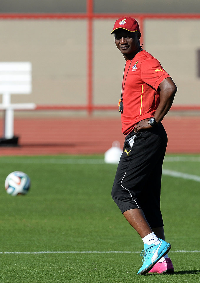 Photo - Ghana's head coach James Appiah walks on the pitch during a training session in Brasilia, Brazil, Wednesday, June 25, 2014. Ghana will play Portugal in group G of the 2014 soccer World Cup on June 26. (AP Photo/Paulo Duarte)