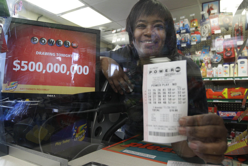 Photo -   Yvette Gavin, 51, sells dreams in the form of Powerball tickets at a BP gas station Wednesday, Nov. 28, 2012 in Calumet Park, Ill. Gavin who has worked as a cashier at the station says she play lotto every once in a while, but with tonight's 500 million dollar jackpot she is defiantly playing today. She says a lot of customers say if they will they will take care of her, but she will have to wait to see. (AP Photo/M. Spencer Green)