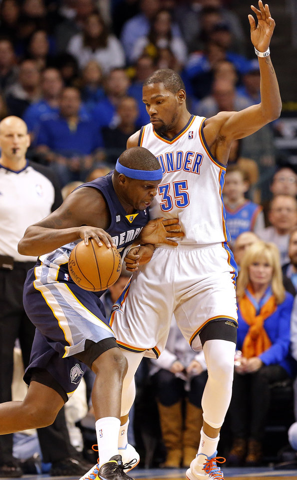 Photo - Oklahoma City's Kevin Durant (35) defends against Memphis' Zach Randolph (50) during the NBA basketball game between the Oklahoma City Thunder and the Memphis Grizzlies at the Chesapeake Energy Arena in Oklahoma City,  Thursday, Jan. 31, 2013.Photo by Sarah Phipps, The Oklahoman