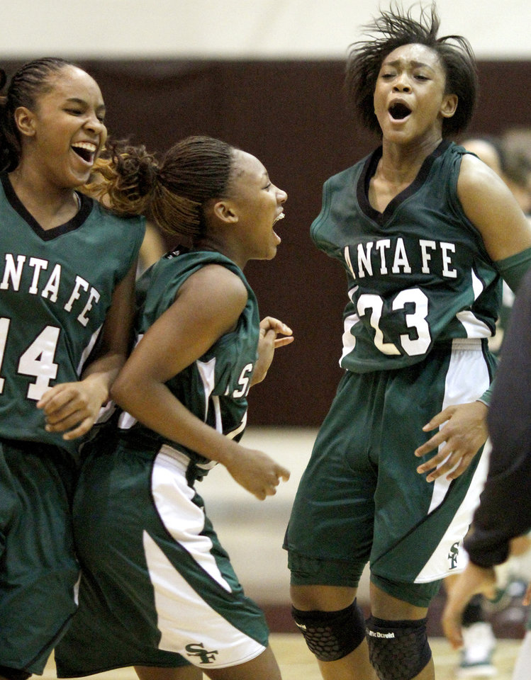 EDLAM / CELEBRATION: Edmond Santa Fe's Courtney Walker, right, celebrates with Cameerah Graves and Daisha Gonzaque, left, after their win over Edmond Memorial in a girls high school basketball game at Edmond Memorial on Tuesday, January 25, 2010.  Photo by Bryan Terry, The Oklahoman