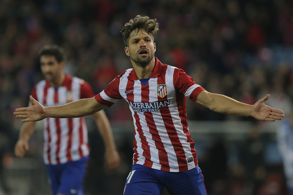 Photo - Atletico's Diego Ribas, celebrates his goal during a Spanish La Liga soccer match between Atletico de Madrid and  Real Sociedad at the Vicente Calderon stadium in Madrid, Spain, Sunday, Feb. 2, 2014. (AP Photo/Andres Kudacki)