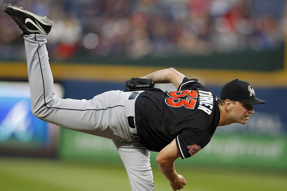 Photo -   Miami Marlins starting pitcher Jacob Turner (33) works in the first inning of a baseball game against Atlanta Braves in Atlanta, Thursday, Sept. 27, 2012. (AP Photo/John Bazemore)