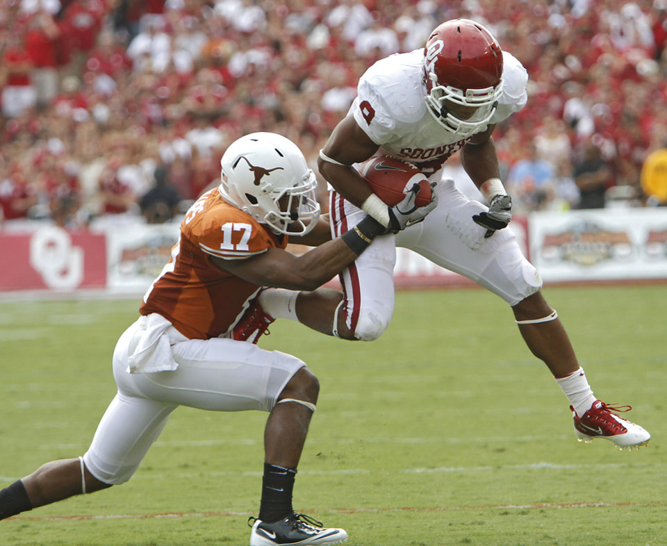 Oklahoma's Dominique Whaley (8) runs past Texas' Adrian Phillips (17) during the Red River Rivalry college football game between the University of Oklahoma Sooners (OU) and the University of Texas Longhorns (UT) at the Cotton Bowl in Dallas, Saturday, Oct. 8, 2011. Photo by Chris Landsberger, The Oklahoman